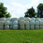 Large stack of wrapped hay bales
